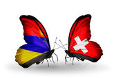 Butterflies with Armenia and  Switzerland flags on wings — Stock Photo
