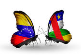 Butterflies with Venezuela and Central African Republic flags on wings — Stok fotoğraf