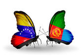 Butterflies with Venezuela and Eritrea flags on wings — Stock Photo