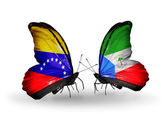 Butterflies with Venezuela and Equatorial Guinea flags on wings — Stok fotoğraf