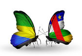 Butterflies with Gabon and Central African Republic flags on wings — Stok fotoğraf