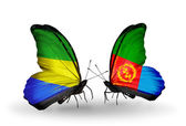 Butterflies with Gabon and Eritrea flags on wings — Stock Photo