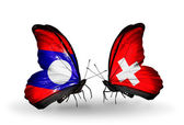 Butterflies with Laos and Switzerland flags on wings — Stok fotoğraf