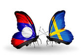 Butterflies with Laos and Sweden flags on wings — Stok fotoğraf