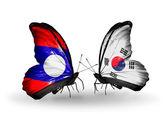 Laos ve güney kore bayraklarıyla kanatlar kelebek — Stok fotoğraf