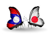 Kelebek kanatları üzerinde japonya ve laos bayrağı ile — Stok fotoğraf