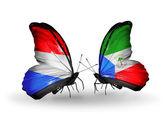 Kelebek kanatları üzerinde lüksemburg ve ekvator ginesi bayraklı — Stok fotoğraf