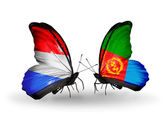 Butterflies with Luxembourg and Eritrea flags on wings — Stock Photo