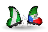 Butterflies with Nigeria and Equatorial Guinea flags on wings — Stock Photo