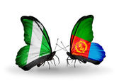 Butterflies with Nigeria and Eritrea flags on wings — Stock Photo