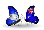 Butterflies with Honduras and Australia flags on wings — Stock Photo