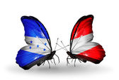 Butterflies with Honduras and Austria flags on wings — Stock Photo