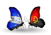 Butterflies with Honduras and Angola flags on wings — Stock Photo