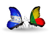 Butterflies with Honduras and Benin flags on wings — Stock Photo