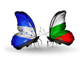 Butterflies with Honduras and Bulgaria flags on wings — Stock Photo