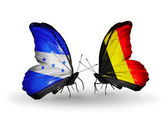 Butterflies with Honduras and Belgium flags on wings — Stock Photo