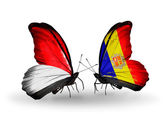 Butterflies with Monaco, Indonesia and Andorra flags on wings — Stock Photo
