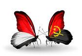 бабочки с монако, индонезии и анголе флаги на крыльях — Стоковое фото