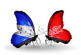 Butterflies with Honduras and Waziristan flags on wings — Stock Photo