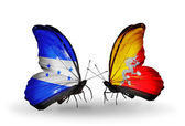 Butterflies with Honduras and  Bhutan flags on wings — Stock Photo