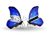 Butterflies with Honduras and Botswana flags on wings — Stock Photo