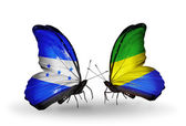 Butterflies with Honduras and Gabon flags on wings — Stock Photo