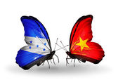 Butterflies with Honduras and Vietnam flags on wings — Stock Photo