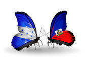 Butterflies with Honduras and Haiti flags on wings — Stock Photo