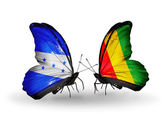Butterflies with Honduras and Guinea flags on wings — Stock Photo