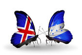 Butterflies with India and Honduras flags on wings — Stock Photo