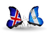 Butterflies with India and Guatemala flags on wings — Stock Photo