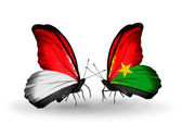 Butterflies with Monaco, Indonesia and Burkina Faso flags on wings — Stock Photo