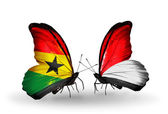 Butterflies with Ghana and Monaco, Indonesia flags on wings — Stock Photo