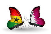Butterflies with Ghana and Qatar flags on wings — Stock Photo