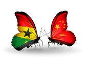 Motýli s příznaky ghana a číny na křídlech — Stock fotografie