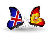 Butterflies with Iceland and Spain flags on wings — Stock Photo