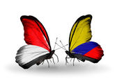Butterflies with Monaco, Indonesia and Columbia flags on wings — Stock Photo