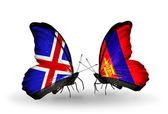 Butterflies with Iceland and Mongolia flags on wings — Stock Photo