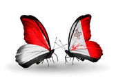Butterflies with Monaco, Indonesia and Malta flags on wings — Stock Photo