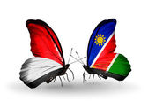 Butterflies with  Monaco, Indonesia and Namibia flags on wings — Stock Photo