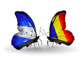 Butterflies with Honduras and  Chad, Romania flags on wings — Stock Photo