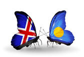 Butterflies with Iceland and Palau flags on wings — Stock Photo