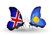 Fjärilar med island och palau flaggor på vingar — Stockfoto