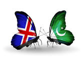 Butterflies with Iceland and Pakistan flags on wings — Stock fotografie