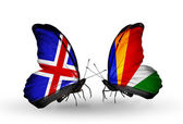 Butterflies with Iceland and Seychelles flags on wings — Stock Photo