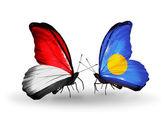 Motýli s příznaky monako, indonésie a palau na křídlech — Stock fotografie