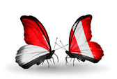 Butterflies with Monaco, Indonesia and Peru flags on wings — Stock fotografie