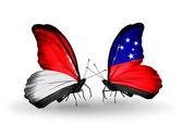 Motýli s monako, indonésie a samoa vlajky na křídlech — Stock fotografie