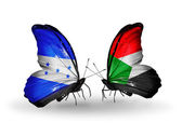 Butterflies with Honduras and   Sudan flags on wings — Stock Photo