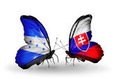 Butterflies with Honduras and  Slovakia flags on wings — Stock Photo